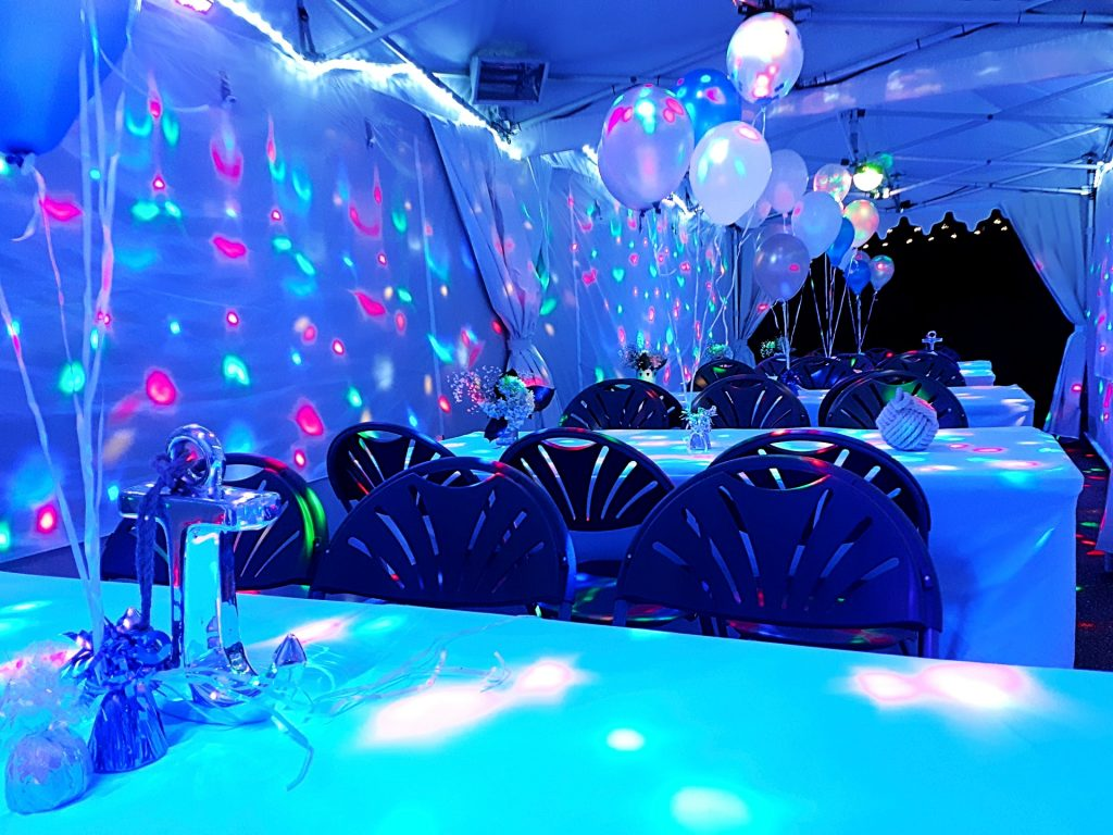 3m x 9m white marquee with disco lights tables and chairs