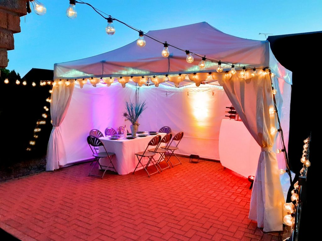White 3m x 4.5m marquee with festoon lights